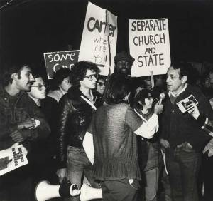 Harvey Milk and Cleve Jones meet the press after Anita Bryant's campaign to repeal anti-discrimination laws passed in Wichita, Kansas, 1978
